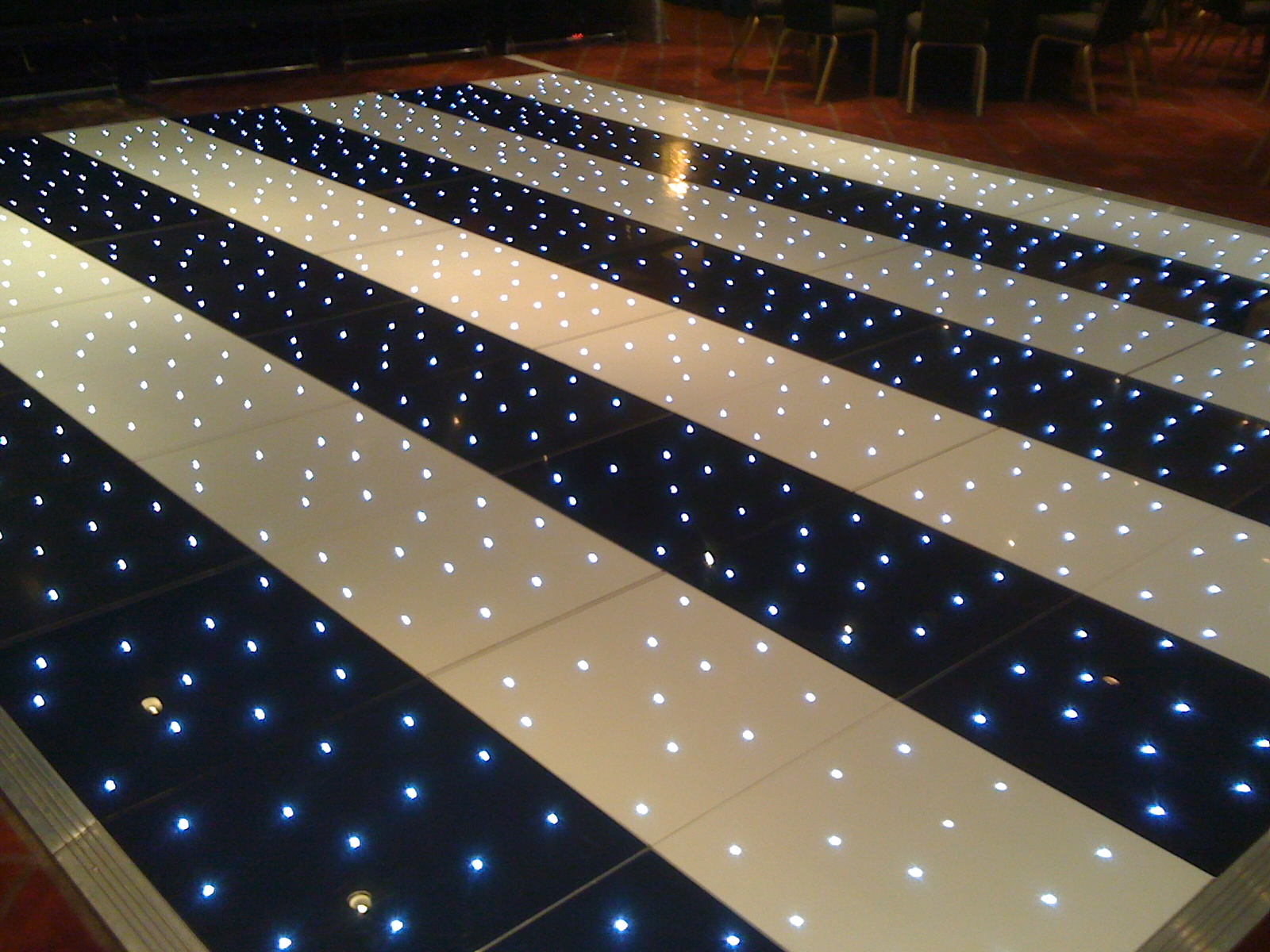 Black and white striped twinkling starlit LED plight dance floors for hire